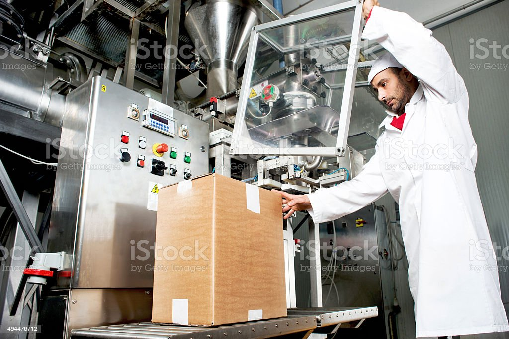 Worker in Packaging Department stock photo