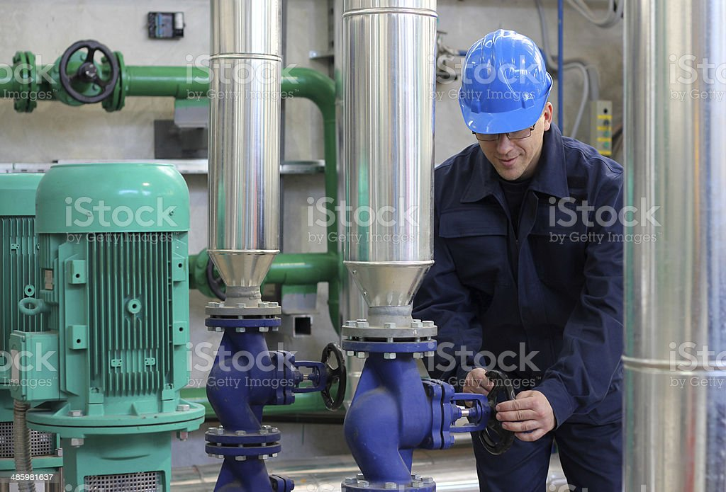Worker in power and heating plant stock photo