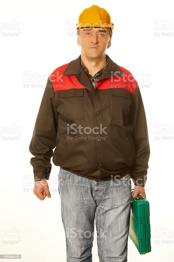Worker in protective orange helmet with a green suitcase stock photo