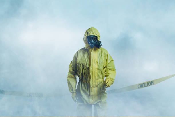 Worker in protective suit stock photo