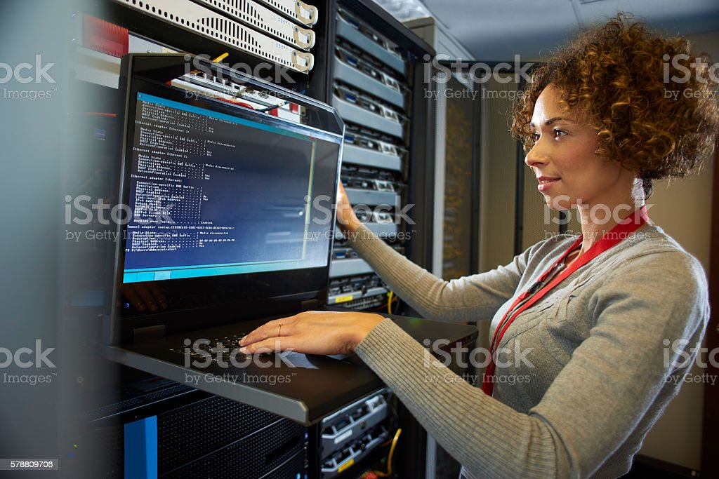 IT worker in server room stock photo