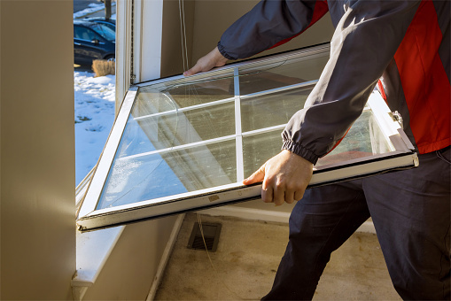 Worker in the removing break down windows in the home renovation living energy efficiency