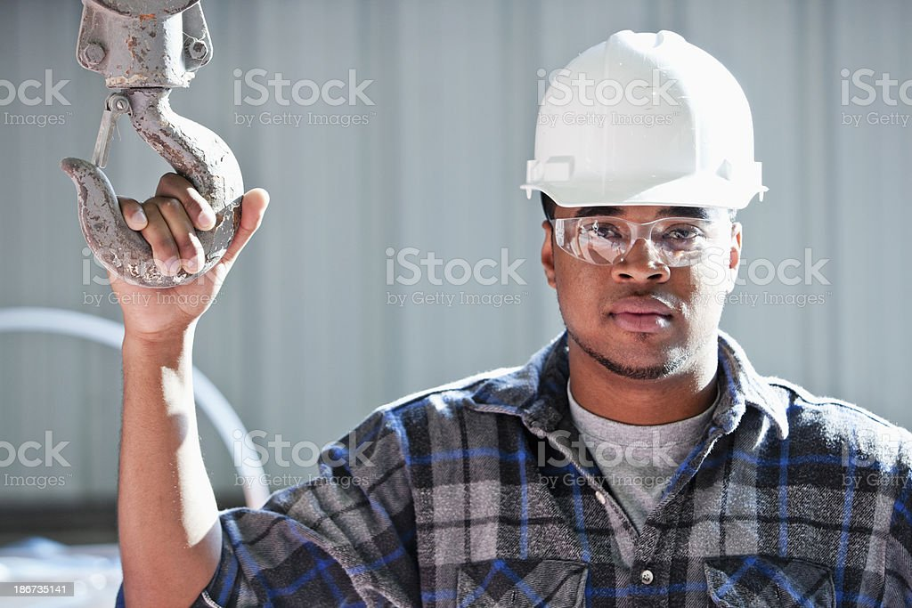 Worker in warehouse with industrial hook stock photo