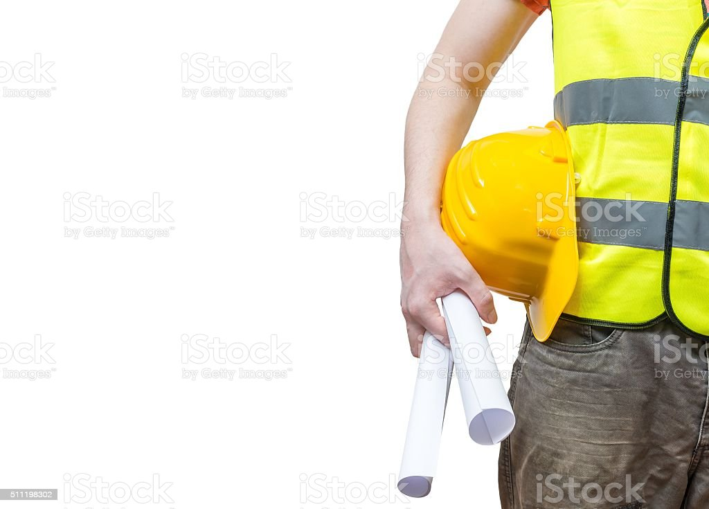 Worker (engineer) in yellow reflective vest holds papers, isolated stock photo