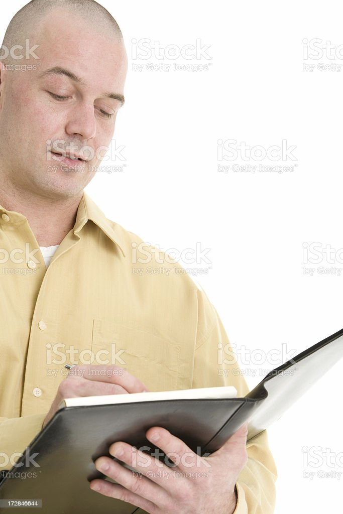 Worker in yellow shirt taking notes royalty-free stock photo