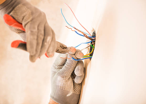 worker instaling electrical wires - Photo