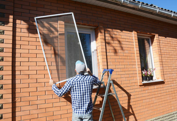 Worker install mosquito net or mosquito wire screen on brick house window. KIEV - UKRAINE, September - 19, 2017: Worker install mosquito net or mosquito wire screen on brick house window. netting stock pictures, royalty-free photos & images