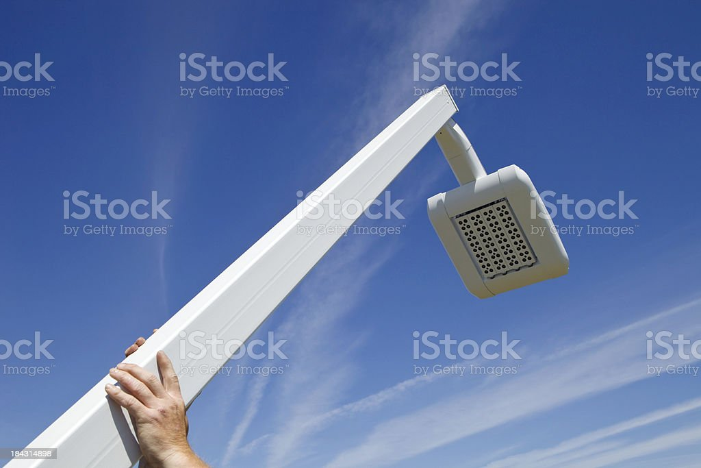 Worker Installing a New LED Street Light royalty-free stock photo