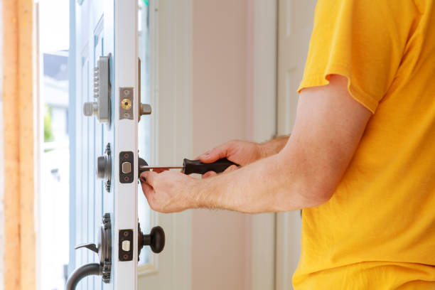 Worker installing or repairing new lock Worker installing or repairing new lock handyman repair the door lock replacement stock pictures, royalty-free photos & images