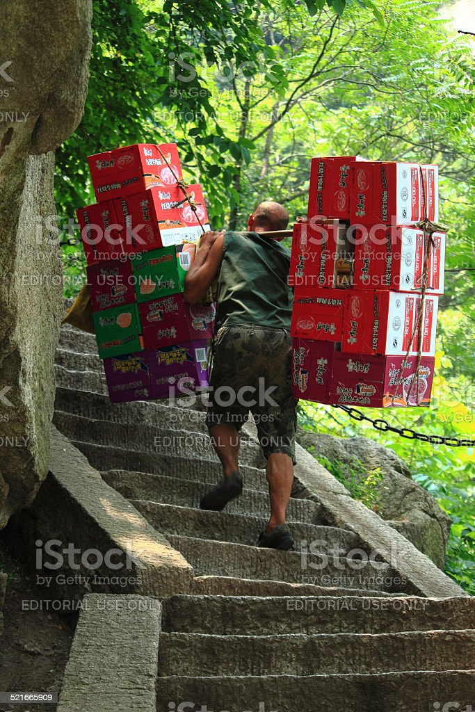 worker is carrying boxes with beverages stock photo