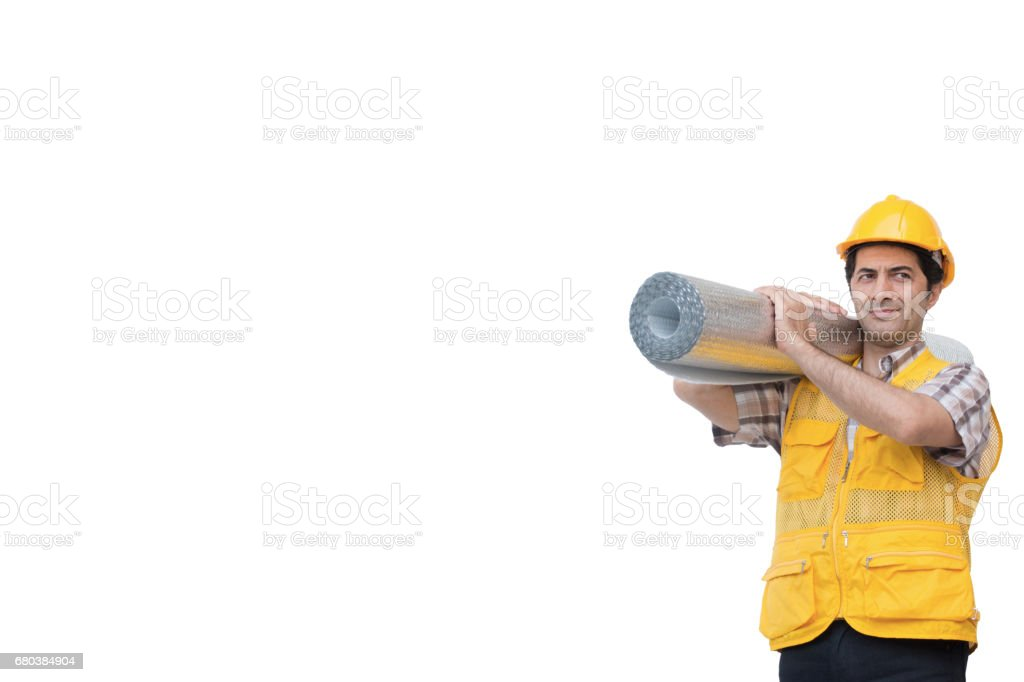 Worker is carrying insulation thermal roll royalty-free stock photo