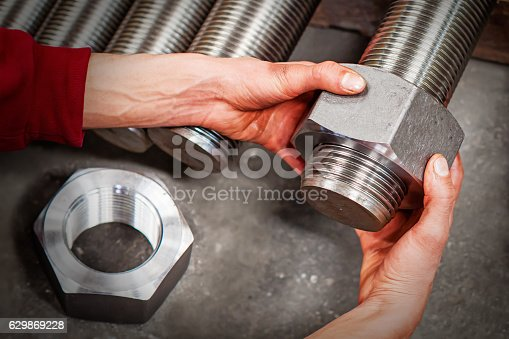 Worker is checking machine parts in workshop