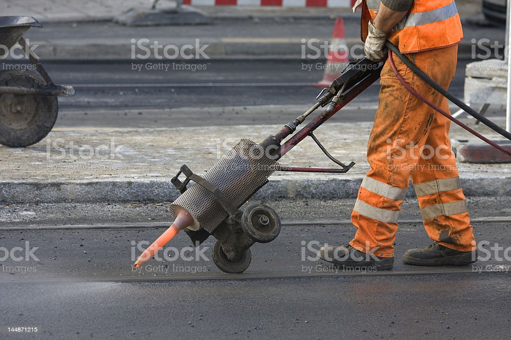 Worker is cleaning rails stock photo