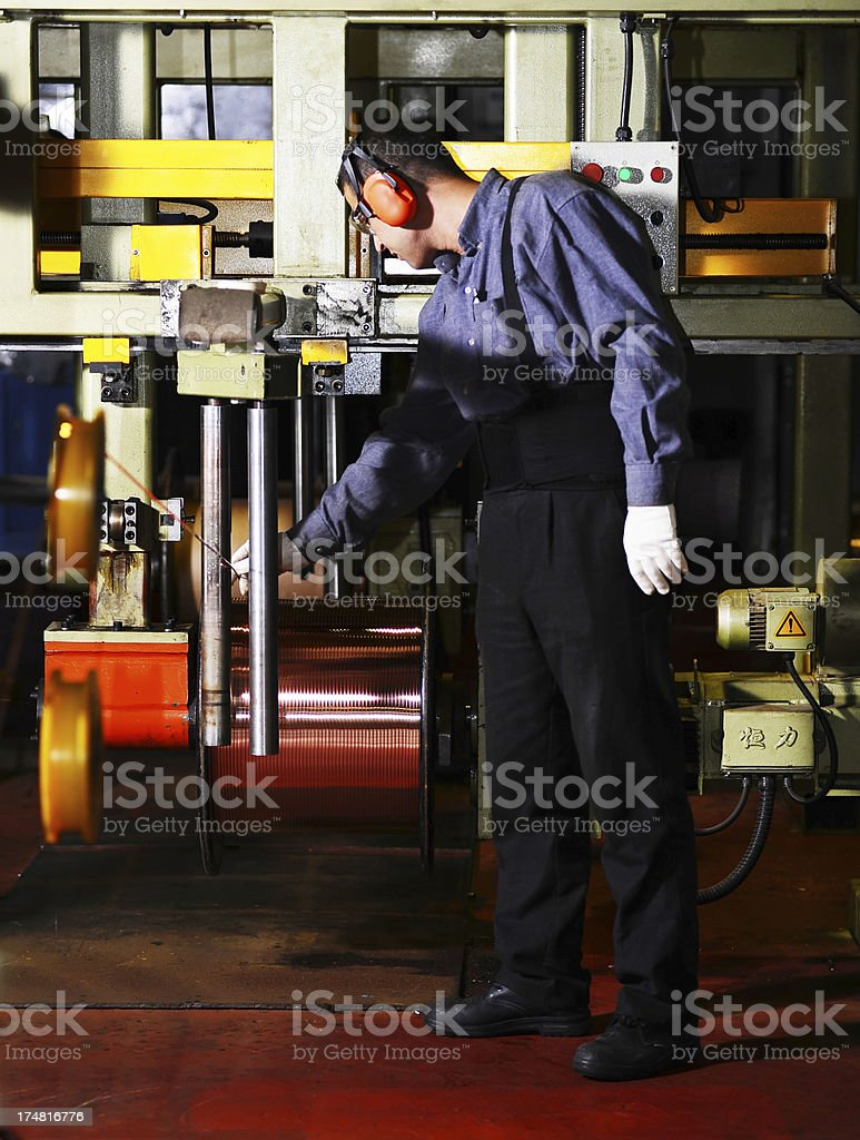 Worker is controlling copper wire quality royalty-free stock photo