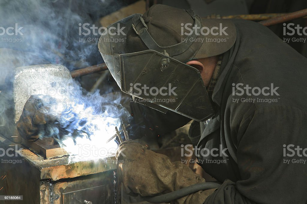 worker is engaged in welding royalty-free stock photo