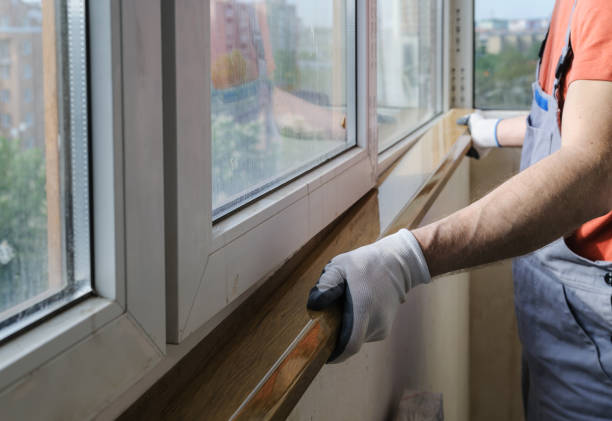 Worker is installing a window sill. Worker is installing a window sill on a polyurethane foam. replacement stock pictures, royalty-free photos & images