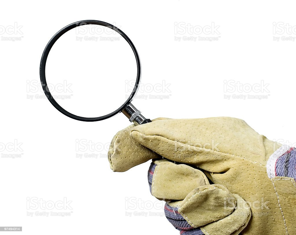 Worker is searching defects with magnifying glass royalty-free stock photo