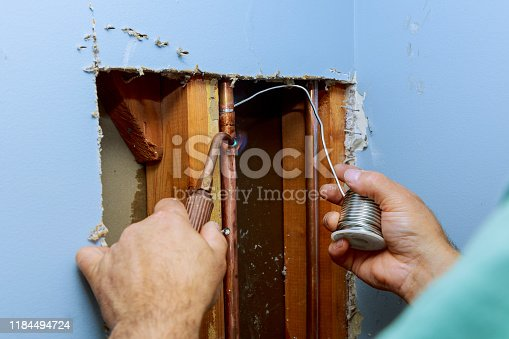 istock A worker is using the gas burner and the solder for copper pipes solder flux paste 1184494724