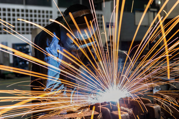 worker is welding assembly automotive part in car factory worker is welding assembly automotive part in car factory natural arch stock pictures, royalty-free photos & images
