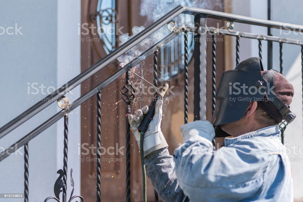 Worker Is Welding Metal Handrails On Outdoor Stairs Forged Items Workflow Working Process Home And Exterior Ukraine Stock Photo Download Image Now Istock