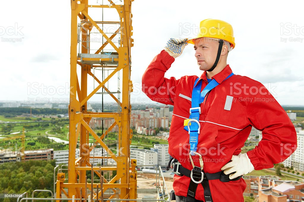 worker joiner at building site stock photo