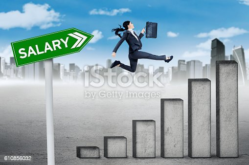 513121118 istock photo Worker jumps with chart and salary word 610856032
