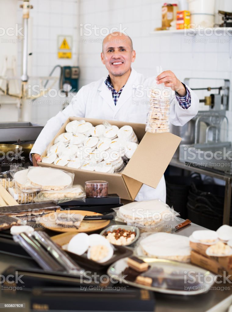 Worker kipping turron in food manufacture stock photo