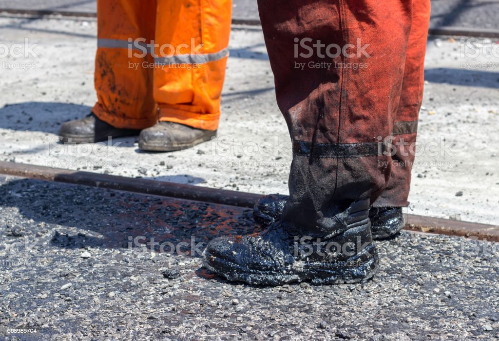 Worker legs with dirty boots stock photo