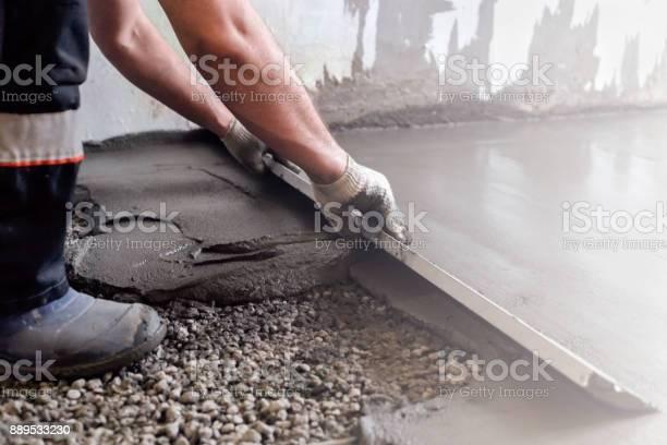 Worker levels a floor cement mortar equal floor repair of the house picture id889533230?b=1&k=6&m=889533230&s=612x612&h=o0rafwzatwyqa64d7htu1cjb92mvb6mxxdc26rhut1s=