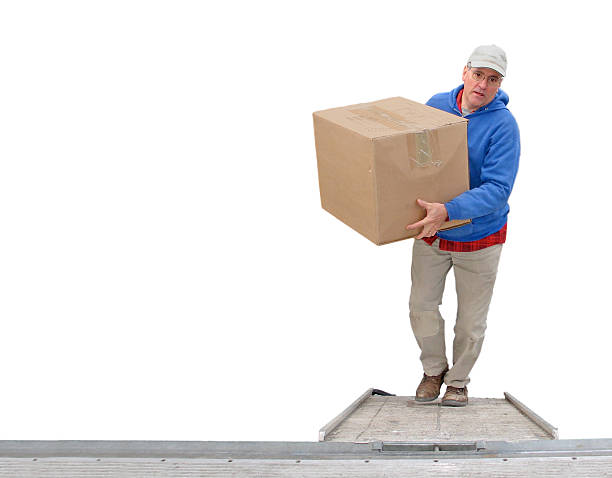 Worker loading a van, isolated stock photo
