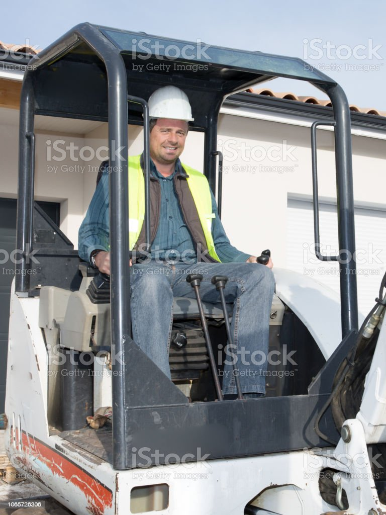 worker machine driver man in construction site stock photo