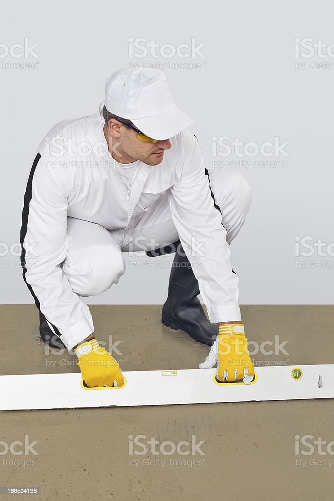 worker makes a luting cement royalty-free stock photo