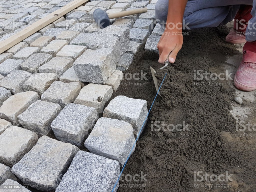 Worker Making a Pavement on a Street stock photo