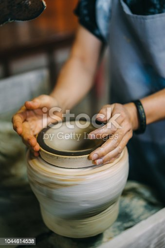 worker making pottery in factory