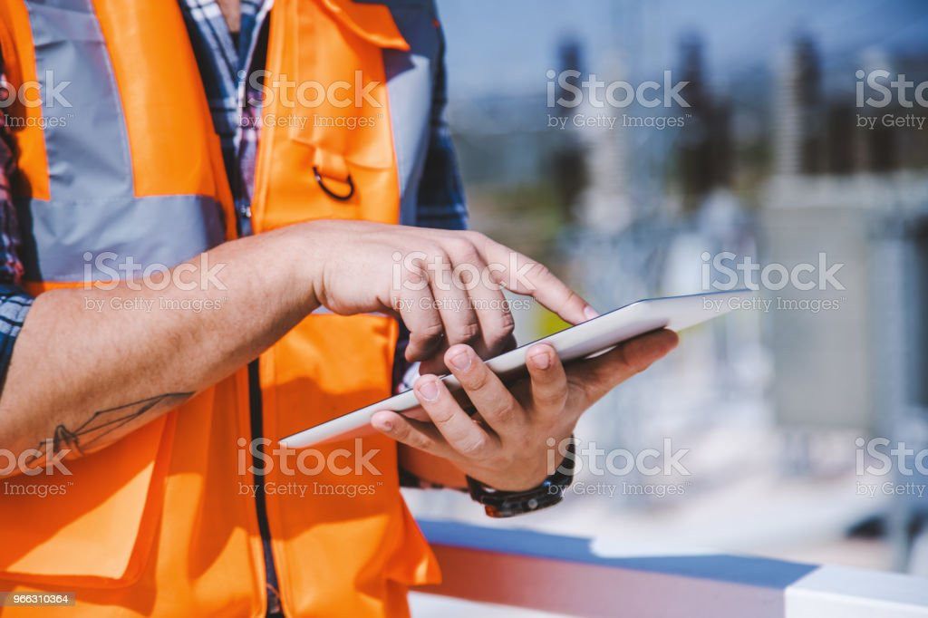 Worker male hand holding and using digital tablet stock photo