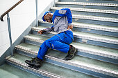 istock Worker Man Lying On Staircase 1212236096