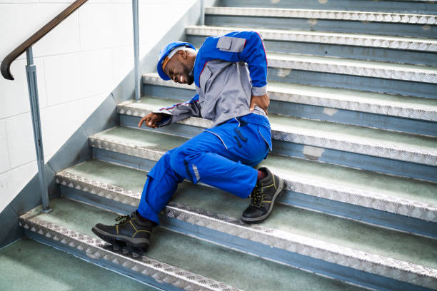 Worker Man Lying On Staircase Worker Man Lying On Staircase After Slip And Fall Accident slippery stock pictures, royalty-free photos & images