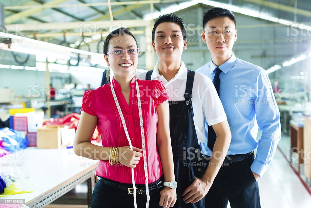 Worker, manager and designer in Chinese factory royalty-free stock photo