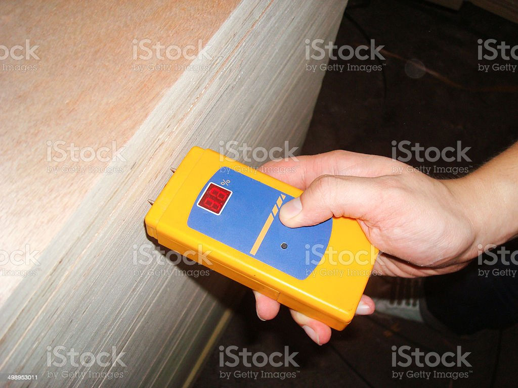 Worker Measuring the Level of Moisture Density for Quality Assurance stock photo