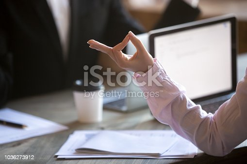 916520034istockphoto Worker meditating at workplace 1036273912