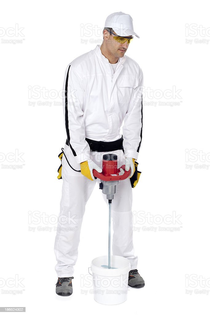 worker mix cement adhesive bucket of machine tool royalty-free stock photo