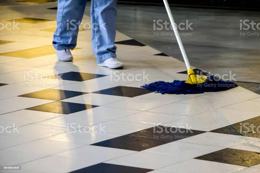 worker mopping to clean floor royalty-free stock photo
