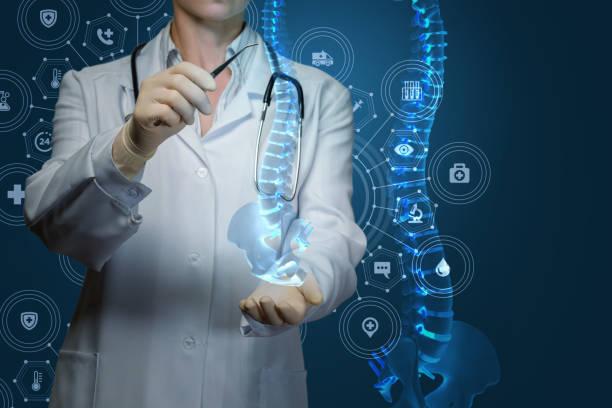 worker of medicine treats the human spine . - spina dorsale umana foto e immagini stock