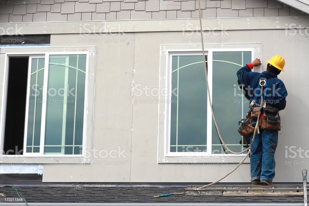 Worker on the roof royalty-free stock photo
