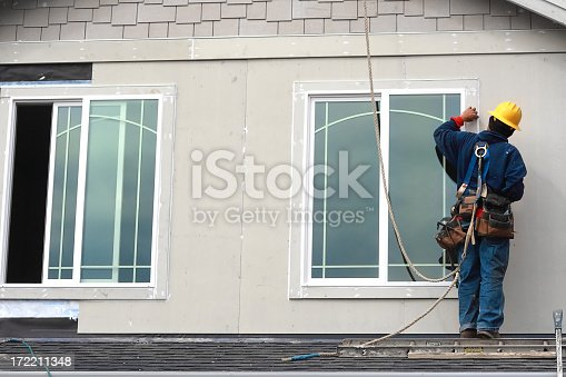 966792200 istock photo Worker on the roof 172211348