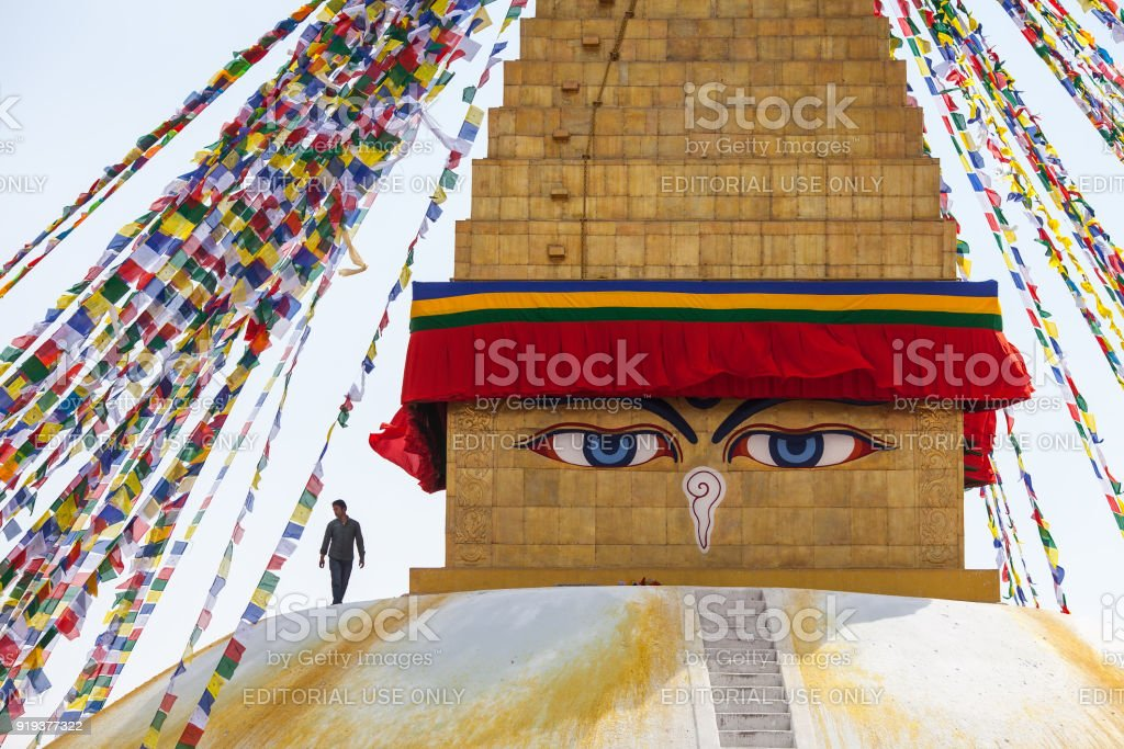 Worker on the top and Buddha eyes. stock photo