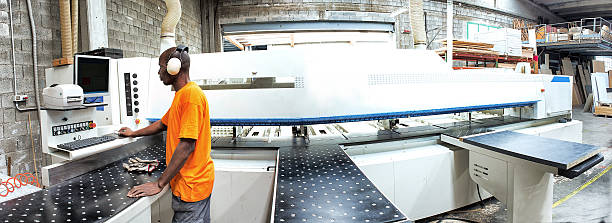 Worker Operating Prouction Machine stock photo