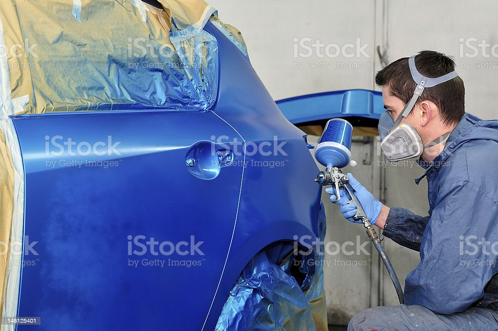 Worker painting a car. royalty-free stock photo
