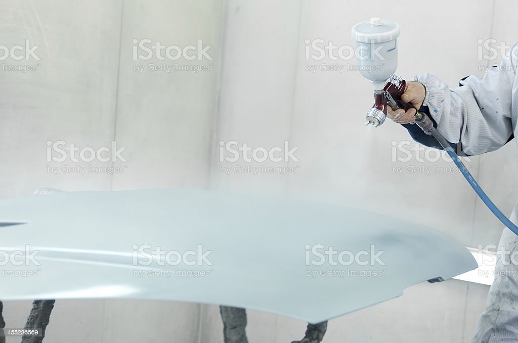 Worker painting a car royalty-free stock photo