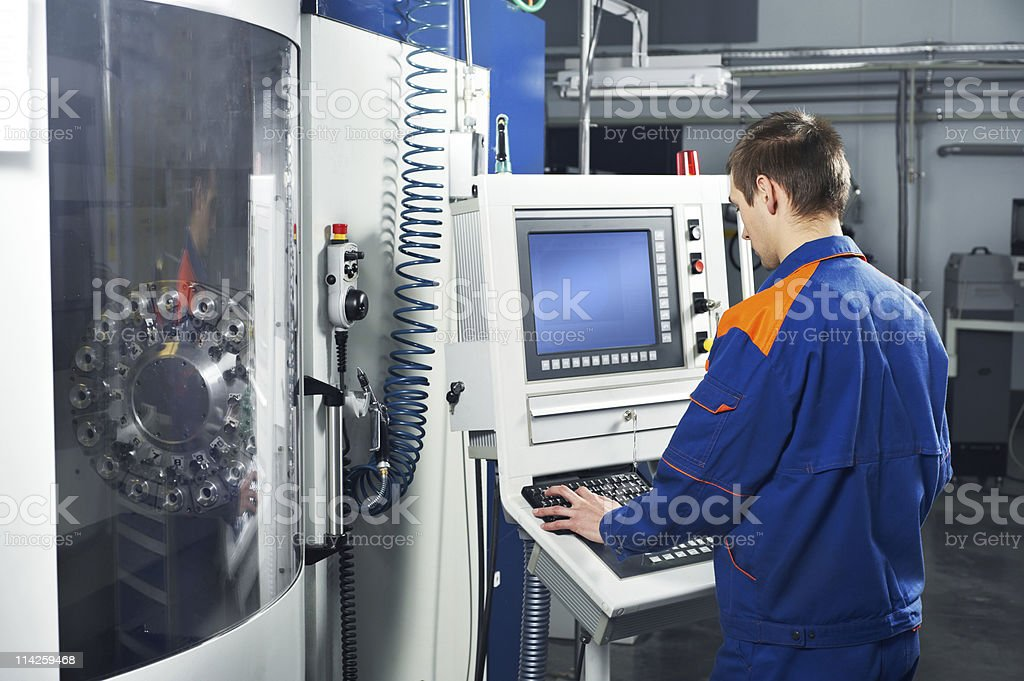 Worker performing a job at tool workshop stock photo